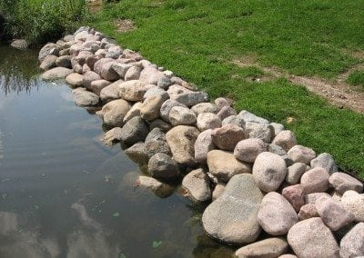Rock wall by water